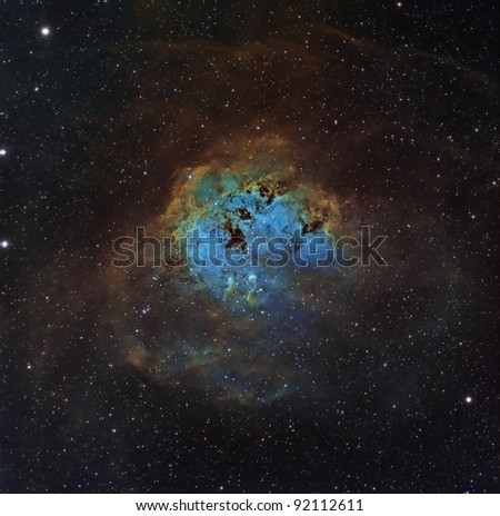 IC 410 or the Tadpole Nebula, done in the Hubble Palette