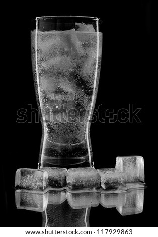 ice and cold water in glass on a black background