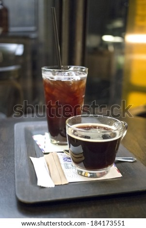 Ice and Hot Coffee in Cafe