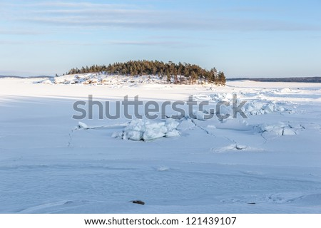Ice and hummocks on the bank of the winter  Barents sea.