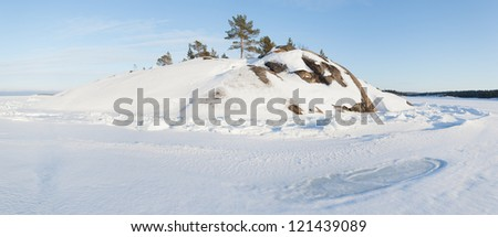 Ice and hummocks on the bank of the winter  Barents sea.  panorama - stock photo