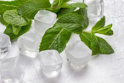 Ice and mint on white background. Top view. Close up