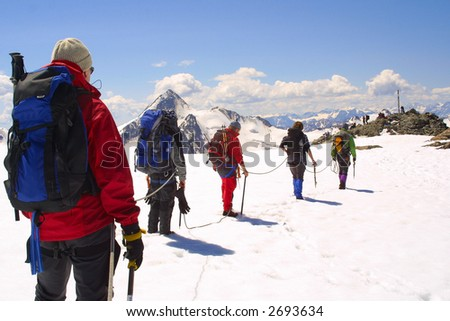 Ice and rock climbing group - stock photo