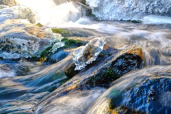 Ice and rocks in a flowing river in Norway