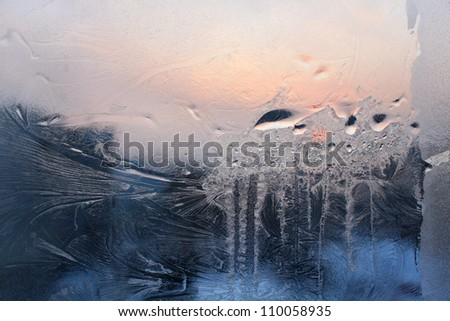 Ice and water drop on a winter glass