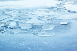 Ice background, frozen lake or river covered by ice.