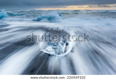 Ice beach and wave of Atlantic sea in jokulsarlon, Iceland.