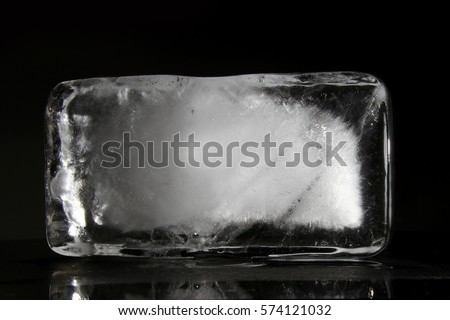 Ice Block / Ice is water frozen into a solid state. Depending on the presence of impurities. it can appear transparent or a more or less opaque bluish-white color. #574121032