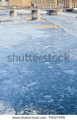 ice blocks on frozen Moscow river in sunny winter day