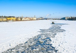 Ice-breaking tug opens the way across the frozen Neva river in a direction of the Palace Bridge. St.-Petersburg. Russia