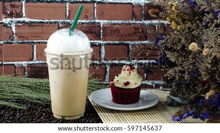 Ice cappuccino coffee and sweet chocolate red velvet cake. Foam milk on top. #597145637