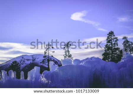 Ice castles and Rocky Mountains at dusk in Dillon Colorado