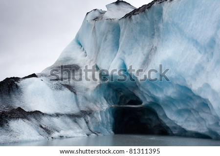 Ice cave inside glacier iceberg in Alaska