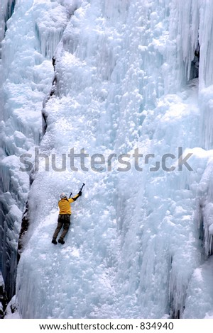 ice climber on huge ice wall