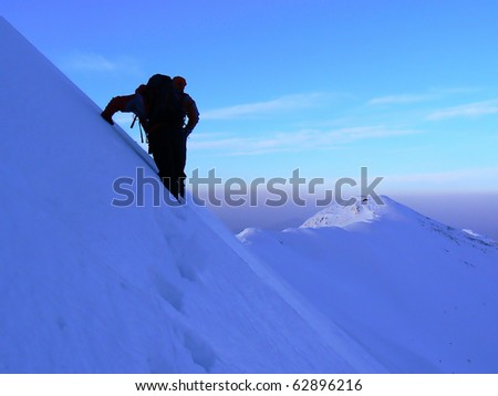 Ice climbing in Piatra Craiului mountains in winter.Piatra Craiului it's a mountain range in the southern Carpathians in Romania.The Piatra Craiului mountains form a narrow and saw-like ridge.