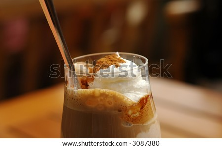 Ice coffee close-up photo with shallow depth of field