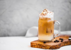 Ice coffee cup with cream. Ice summer refreshing coffee drink with cream
