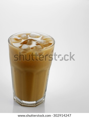 Ice coffee in a glass over gray background #302914247