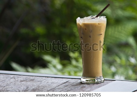 Ice coffee on a wooden table