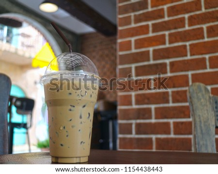 Ice Coffee on table with brick background #1154438443