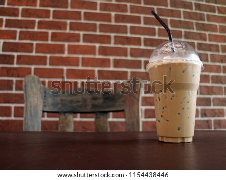 Ice Coffee on table with brick background #1154438446