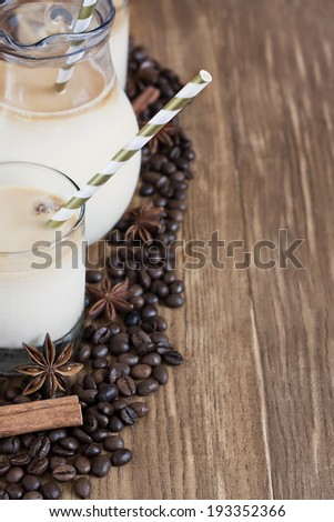 Ice coffee with spices in jug and glasses. Selective focus. Copy space background.