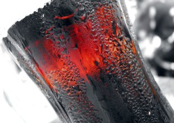 Ice cold refreshing Coca cola glass coke drink on white background
