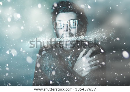 Ice cold winter art of a man holding explosive thermometer in shivering jaw while in a freeze of snow and frost from a blizzard of falling white ice. Temperature below freezing #335457659