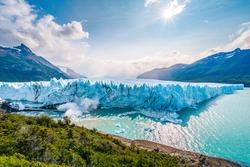 Ice collapsing into the water at Perito Moreno Glacier in Los Glaciares National Park near El Calafate, Patagonia Argentina, South America.