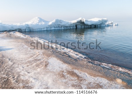 Ice-covered breakwater. Baltic sea. Kaliningrad region. Russia