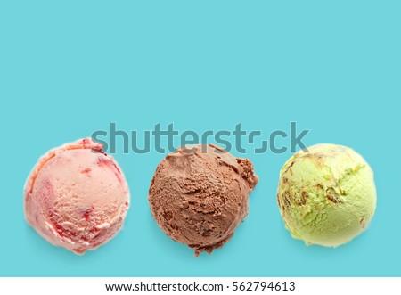 Ice cream balls on a blue background #562794613