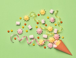Ice Cream Cone with Candies Sweets. Marshmallow, Meringue background. Flat lay. Summer Party, Birthday Firework. Vanilla Pastel Color. Trendy fashion Style. Minimal. Art