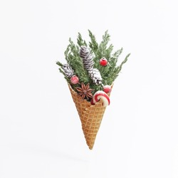 Ice Cream Cone with Christmas Decoration. Creative Christmas Concept.