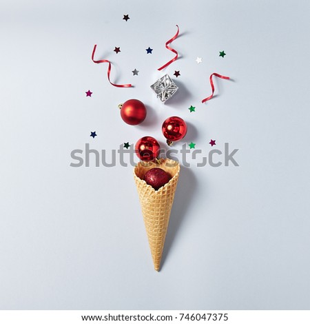 Ice Cream Cone with Christmas Decoration. Minimal Christmas Concept. Flat Lay #746047375