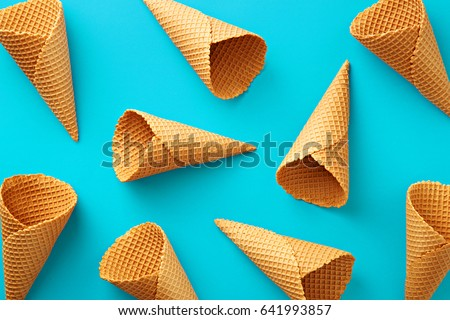 Ice cream cones pattern. Turquoise background. Sweet, summer and empty concept. Top view. Flat lay