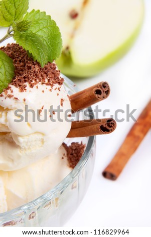 Ice-cream decorated with cinnamon and mint. Isolated on white background