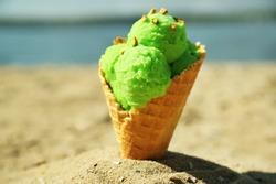 Ice cream in sand on beach