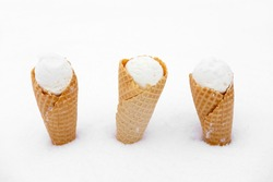 ice cream in waffle cone in snow
