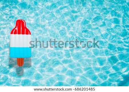 Ice Cream pool float, ring floating in a refreshing blue swimming pool