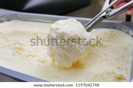 ice cream scoop, scooped out of a container with a utensil,Vanilla