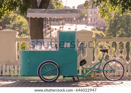 ice cream seller with bicycle...
