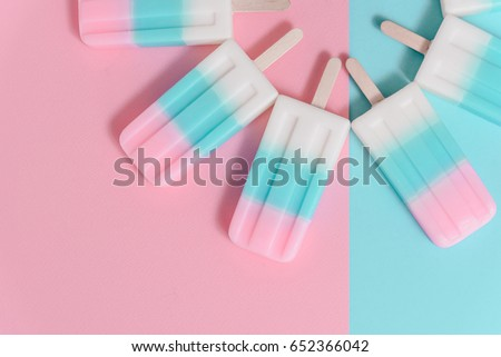 Ice cream sticks on pastel colors background
