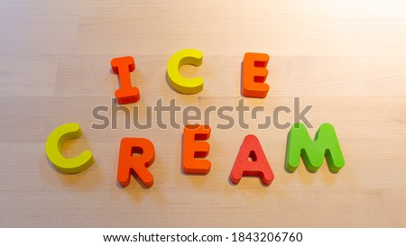 Photo of  Ice cream text, jumping words for celebration concept. Social media. holiday celebration creative image. Descriptive seamless looping video for b-roll or title