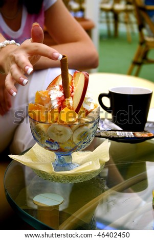 ice cream topped with syrup and fruits