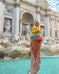 ice cream view on the fountain Rome ancient buildings