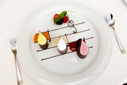 Ice cream with fruit adorned with chocolate in the form of musical notes