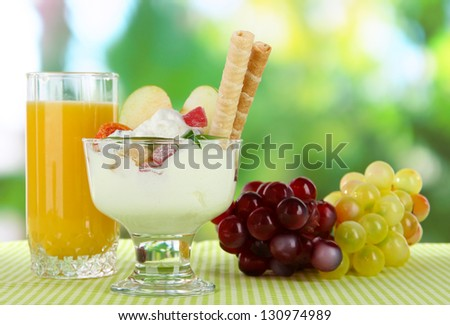 Ice cream with wafer sticks  on nature background