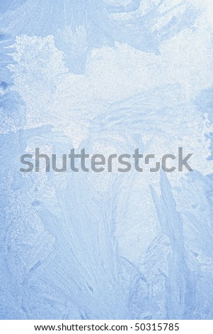 ice crystals on window in winter