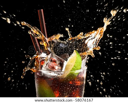 Ice cube and lime splashing cola glass,     Cuba Libre, black backround, close up