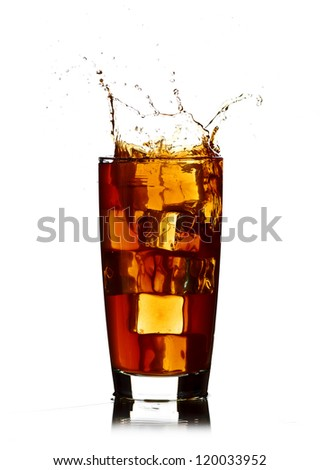 Ice cube droped in cola glass isolated on white background